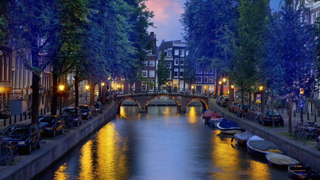 16 Aug 2010, Amsterdam, Netherlands --- Canal at night in Amsterdam --- Image by © Jean-Pierre Lescourret/Corbis